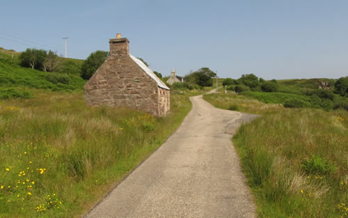The road down to Cove Slipway is opposite the cottage